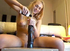 Kirmess lover rides a fat dildo almost the brush asshole
